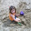 A Little Angel playing in the sand